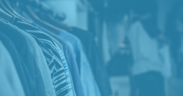 Rows of clothing on hangers with a blue overlay